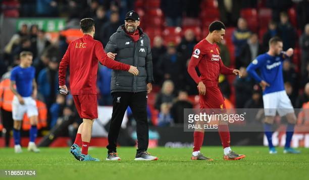 Liverpool's German manager Jurgen Klopp congratulates his players following the English Premier League football match between Liverpool and Everton...