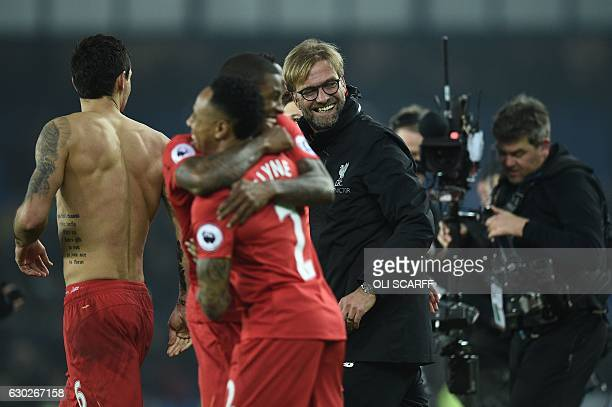 Liverpool's German manager Jurgen Klopp congratulates his players following the English Premier League football match between Everton and Liverpool...