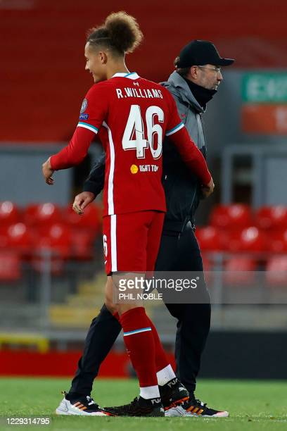 Liverpool's German manager Jurgen Klopp congratulates Liverpool's English defender Rhys Williams on the pitch after the UEFA Champions league Group D...