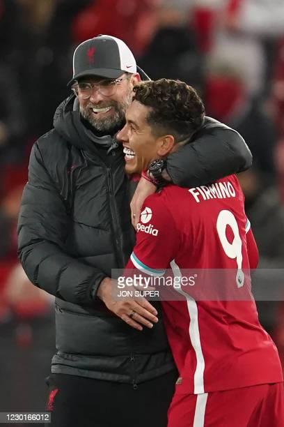 Liverpool's German manager Jurgen Klopp embraces Liverpool's Brazilian midfielder Roberto Firmino after the English Premier League football match...