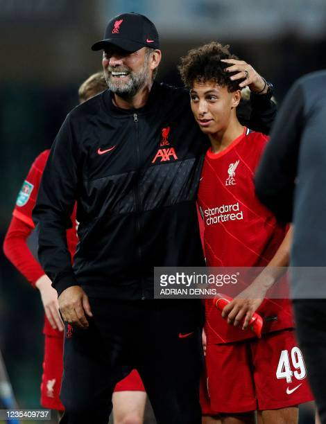 Liverpool's German manager Jurgen Klopp embraces Liverpool's English striker Kaide Gordon after the English League Cup third round football match...