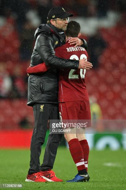 Liverpool's German manager Jurgen Klopp embraces Liverpool's Scottish defender Andrew Robertson on the pitch after the UEFA Champions League round of...