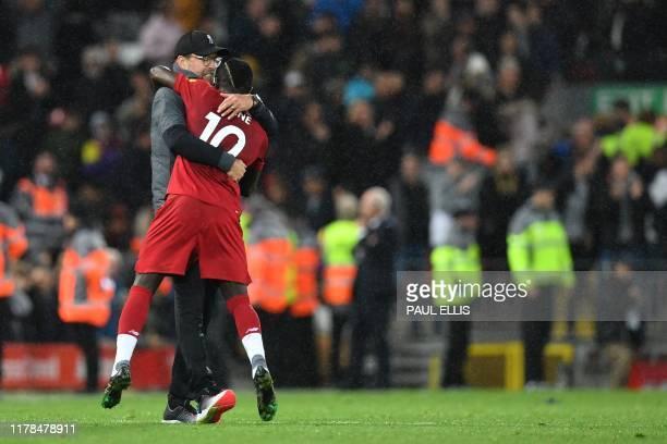 Liverpool's German manager Jurgen Klopp embraces Liverpool's Senegalese striker Sadio Mane after winning the English Premier League football match...