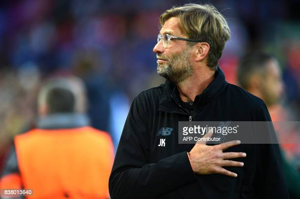 Liverpool's German manager Jurgen Klopp gestures before the Champions League qualifier second leg match between Liverpool and Hoffenheim at Anfield...