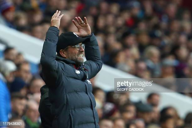 Liverpool's German manager Jurgen Klopp gestures during the English Premier League football match between Aston Villa and Liverpool at Villa Park in...