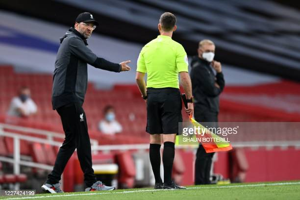 Liverpool's German manager Jurgen Klopp gestures to an assistant referee during the English Premier League football match between Arsenal and...