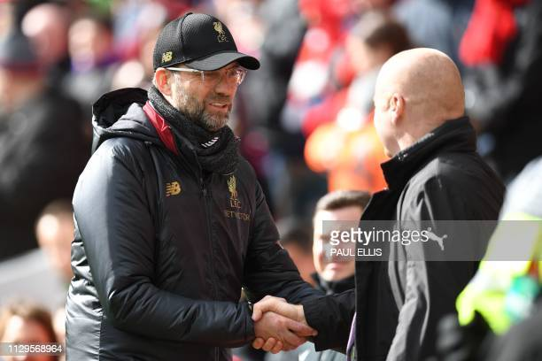 Liverpool's German manager Jurgen Klopp greets Burnley's English manager Sean Dyche before kick off of the English Premier League football match...