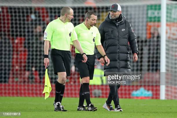 Liverpool's German manager Jurgen Klopp has words with English referee Kevin Friend on the pitch after the English Premier League football match...