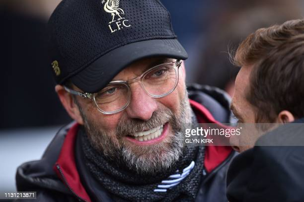 Liverpool's German manager Jurgen Klopp hats to Fulham's English caretaker manager Scott Parker prior to the English Premier League football match...