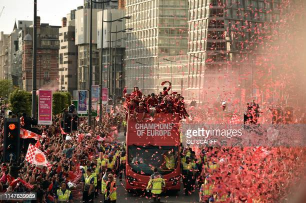 Liverpool's German manager Jurgen Klopp holds the European Champion Clubs' Cup trophy during an opentop bus parade around Liverpool northwest England...