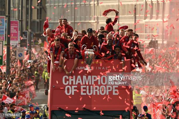 Liverpool's German manager Jurgen Klopp holds the European Champion Clubs' Cup trophy during an open-top bus parade around Liverpool, north-west...