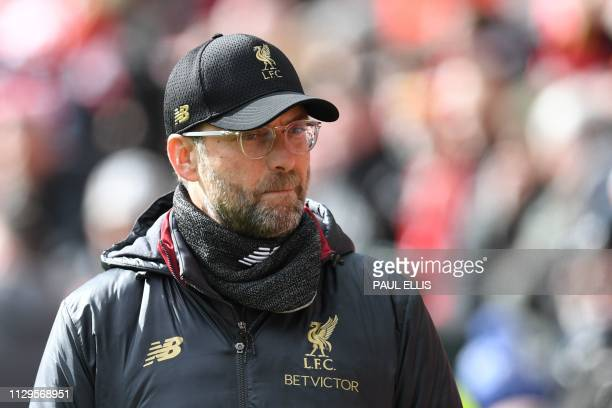 Liverpool's German manager Jurgen Klopp is seen before kick off of the English Premier League football match between Liverpool and Burnley at Anfield...