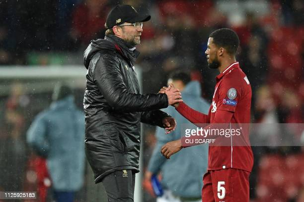 Liverpool's German manager Jurgen Klopp L0 shakes hands with Liverpool's Dutch midfielder Georginio Wijnaldum on the pitch after the UEFA Champions...