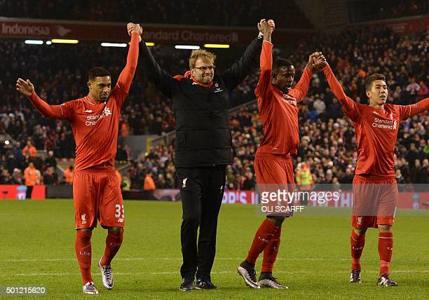 Liverpool's German manager Jurgen Klopp leads his players in saluting the crowd with Liverpool's English midfielder Jordon Ibe Liverpool's Belgian...