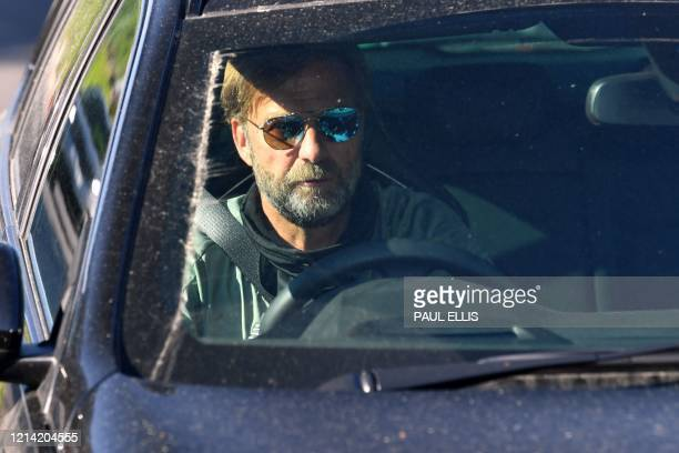 Liverpool's German manager Jurgen Klopp leaves from Liverpool's training ground at Melwood in Liverpool north west England on May 20 as training...