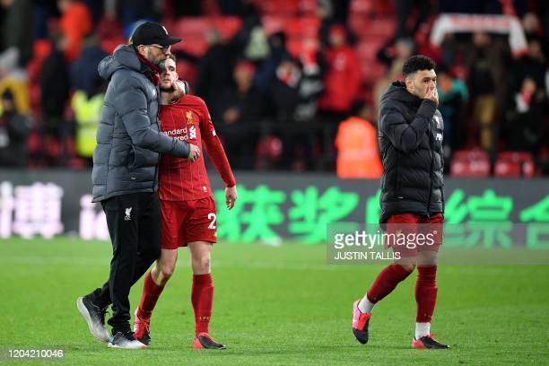 Liverpool's German manager Jurgen Klopp Liverpool's Scottish defender Andrew Robertson and Liverpool's English midfielder Alex OxladeChamberlain...