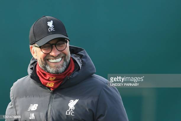 Liverpool's German manager Jurgen Klopp looks on during a training session at Melwood in Liverpool north west England on February 17 on the eve of...