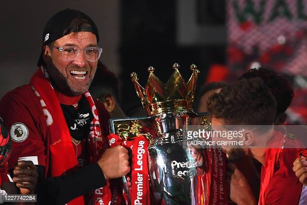 Liverpool's German manager Jurgen Klopp poses with the Premier League trophy during the presentation following the English Premier League football...