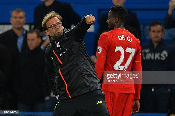 Liverpool's German manager Jurgen Klopp punches the air at the end of the English Premier League football match between Chelsea and Liverpool at...