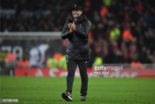 Liverpool's German manager Jurgen Klopp reacts after the UEFA Champions League group C football match between Liverpool and Napoli at Anfield stadium...