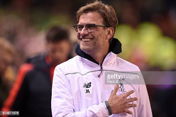 Liverpool's German manager Jurgen Klopp reacts ahead of the UEFA Europa League round of 16 first leg football match between Liverpool and Manchester...