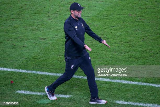 Liverpool's German manager Jurgen Klopp reacts during the 2019 FIFA Club World Cup Final football match between England's Liverpool and Brazil's...
