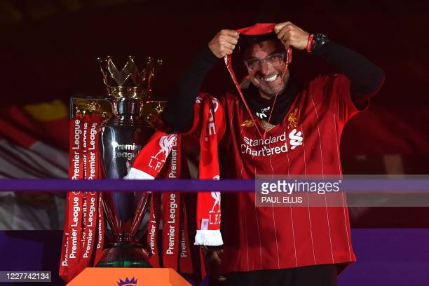 Liverpool's German manager Jurgen Klopp reacts during the trophy presentation following the English Premier League football match between Liverpool...