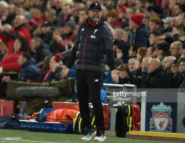 Liverpool's German manager Jurgen Klopp reacts during the UEFA Champions league Group E football match between Liverpool and Napoli at Anfield in...