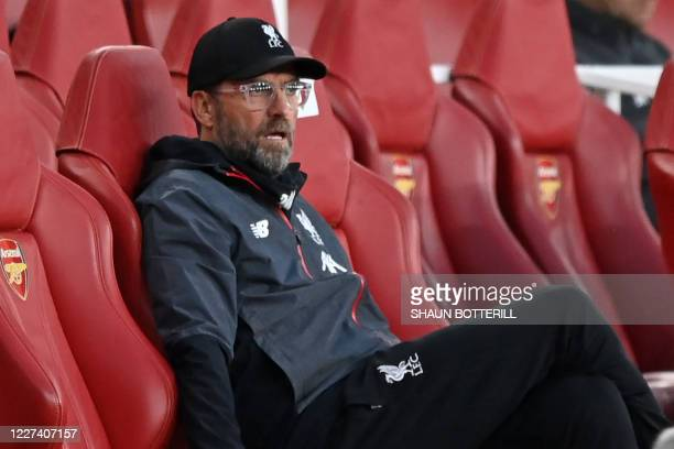 Liverpool's German manager Jurgen Klopp reacts in his seat after Liverpool concede their second goal during the English Premier League football match...