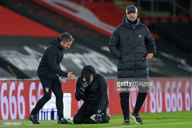 Liverpool's German manager Jurgen Klopp reacts to their defeat as Southampton's Austrian manager Ralph Hasenhuttl celebrates after the English...