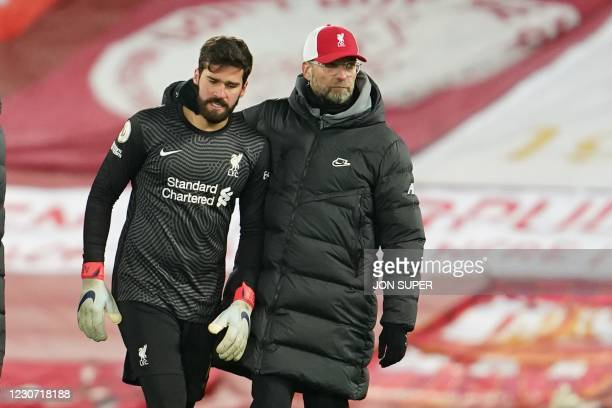 Liverpool's German manager Jurgen Klopp reacts with Liverpool's Brazilian goalkeeper Alisson Becker at the end of the English Premier League football...