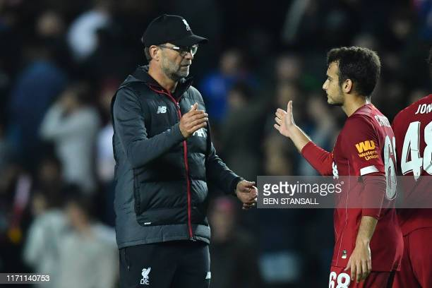 Liverpool's German manager Jurgen Klopp reacts with Liverpool's Spanish midfielder Pedro Chirivella at the final whistle during the English League...