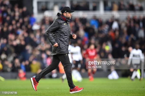 Liverpool's German manager Jurgen Klopp runs back to the dressing room at during the English Premier League football match between Fulham and...