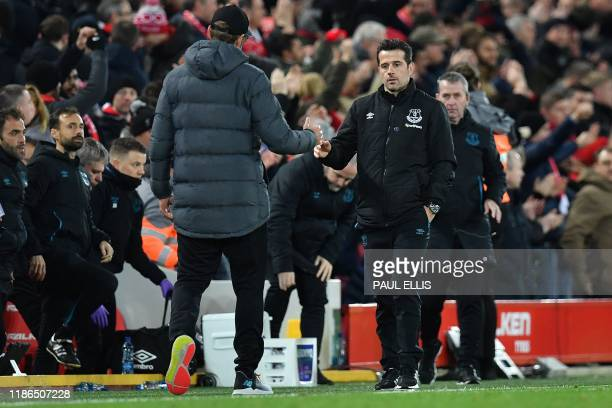 Liverpool's German manager Jurgen Klopp shakes hands with Everton's Portuguese manager Marco Silva after the English Premier League football match...