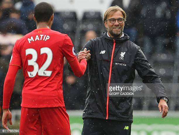 Liverpool's German manager Jurgen Klopp shakes hands with Liverpool's Germanborn Cameroonian defender Joel Matip at the end of the English Premier...