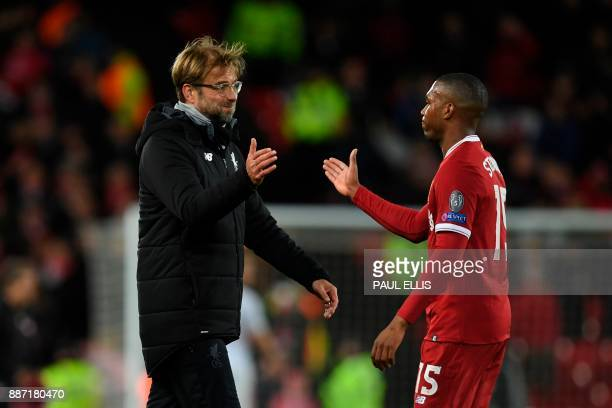 Liverpool's German manager Jurgen Klopp shakes hands with Liverpool's English striker Daniel Sturridge at the end of the UEFA Champions League Group...