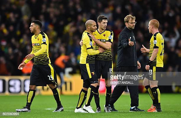 Liverpool's German manager Jurgen Klopp shakes hands with Watford's English midfielder Ben Watson as Watford players celebrate on the pitch after the...