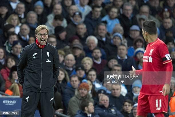 Liverpool's German manager Jurgen Klopp shouts at Liverpool's Brazilian striker Roberto Firmino during the English Premier League football match...