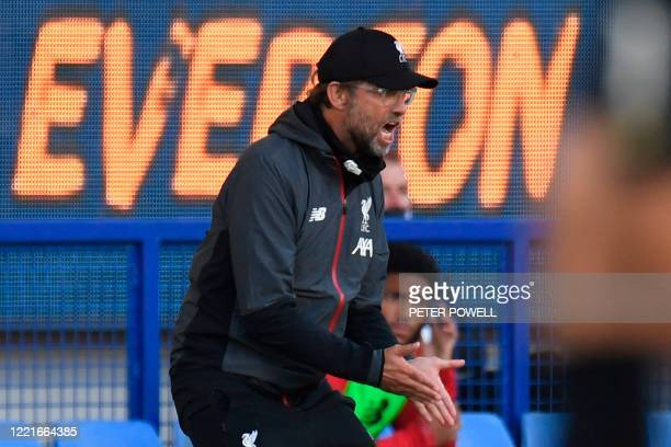Liverpool's German manager Jurgen Klopp shouts from the touchline during the English Premier League football match between Everton and Liverpool at...