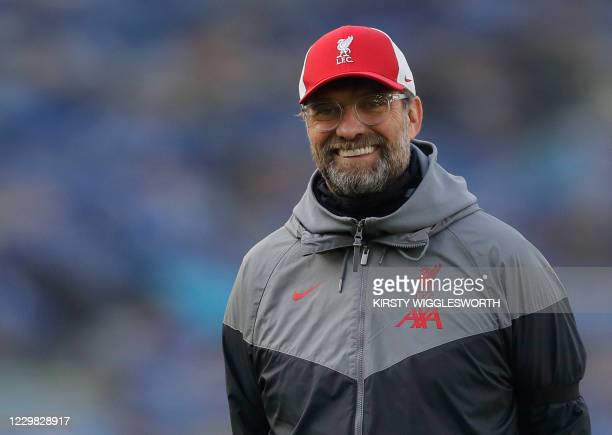 Liverpool's German manager Jurgen Klopp smiles ahead of the English Premier League football match between Brighton and Hove Albion and Liverpool at...