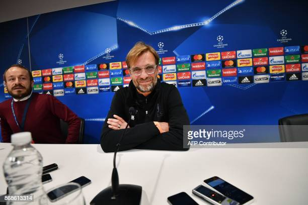 Liverpool's German manager Jurgen Klopp smiles as he attends a press conference at Anfield stadium in Liverpool north west England on October 31 on...