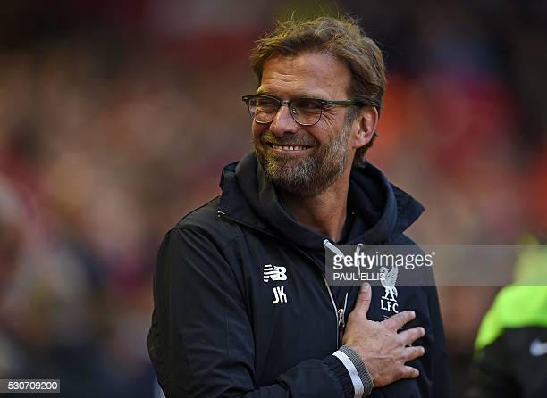 Liverpool's German manager Jurgen Klopp smiles as he waits for kick off in the English Premier League football match between Liverpool and Chelsea at...