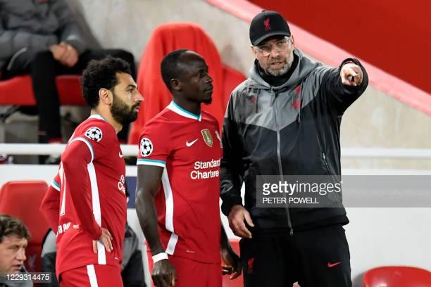 Liverpool's German manager Jurgen Klopp speaks with Liverpool's Senegalese striker Sadio Mane and Liverpool's Egyptian midfielder Mohamed Salah as...