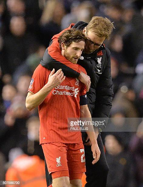 Liverpool's German manager Jurgen Klopp speaks with Liverpool's Welsh midfielder Joe Allen after the end of the English FA Cup fourth round football...