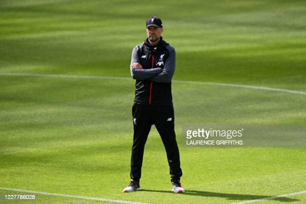 Liverpool's German manager Jurgen Klopp stands on the pitch during a training session prior to the English Premier League football match between...