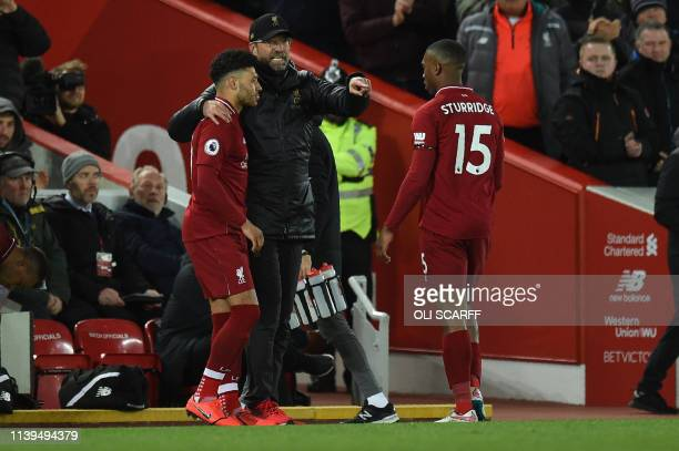 Liverpool's German manager Jurgen Klopp substitutes Liverpool's English striker Daniel Sturridge for Liverpool's English midfielder Alex...