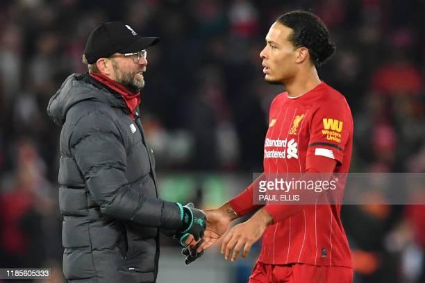 Liverpool's German manager Jurgen Klopp talks with Liverpool's Dutch defender Virgil van Dijk following the English Premier League football match...