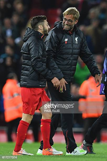 Liverpool's German manager Jurgen Klopp talks with Liverpool's English midfielder Adam Lallana after the English Premier League football match...