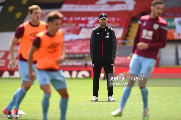 Liverpool's German manager Jurgen Klopp watches Burnley players warm up ahead of the English Premier League football match between Liverpool and...