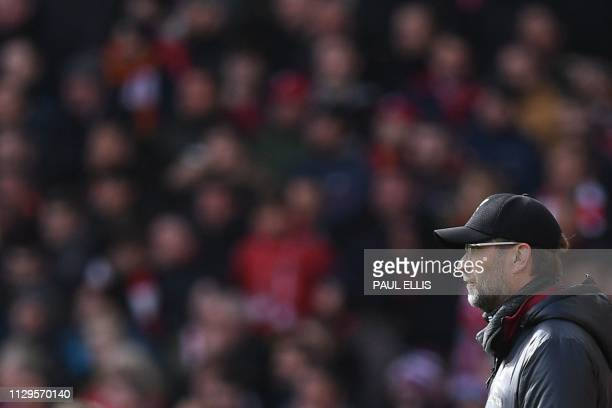 Liverpool's German manager Jurgen Klopp watches from the touchline during the English Premier League football match between Liverpool and Burnley at...